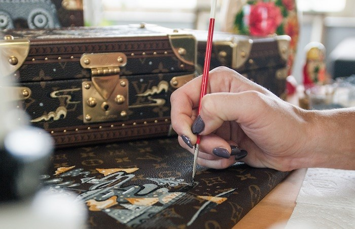 Ola Volo was chosen to paint a set of three classic Louis Vuitton trunks as part of the brand's celebration of its 35th year in Canada. - Riaz Oozeer