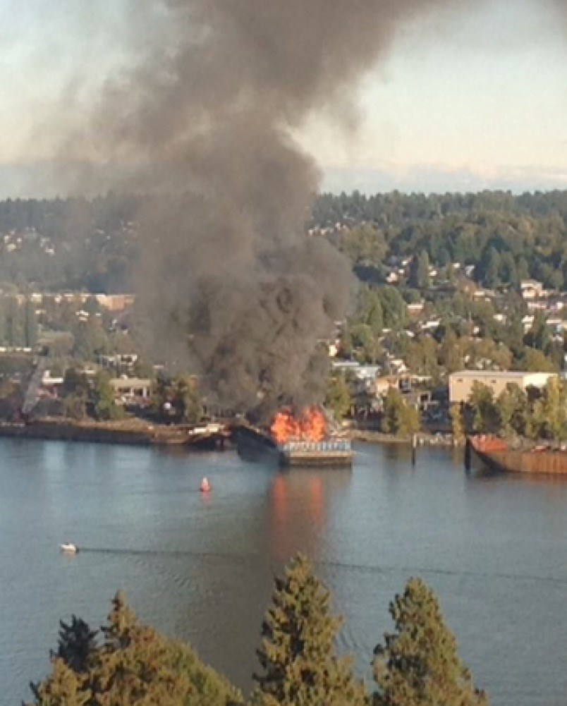 Flames can be seen from high ground in New Westminster. Photograph By MATT LORENZI