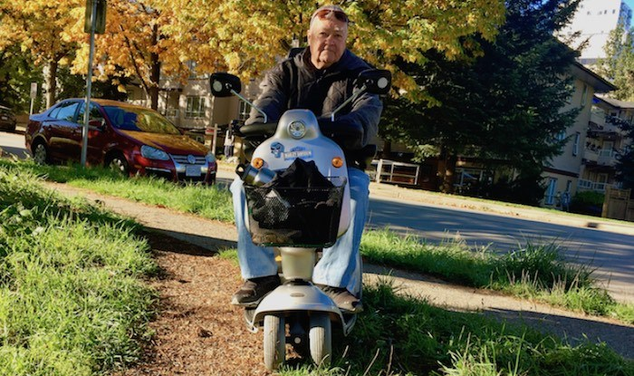 Wayne McQueen has to navigate Smith Avenue on his scooter where, in places, there are no curb letdowns. (Photograph By Maria Rantanen)