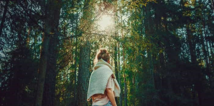 Photo: woman in the woods / Shutterstock
