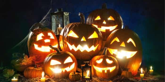 Photo: Halloween pumpkin head jack lantern with burning candles / Shutterstock