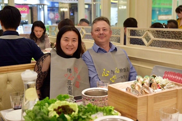 Lucy Liu, owner of the Dolar Shop, poses for a photo with Wayne Kolins, food service manager at the restaurant's fish supplier (Frobisher International Ltd). Photo: Megan Devlin