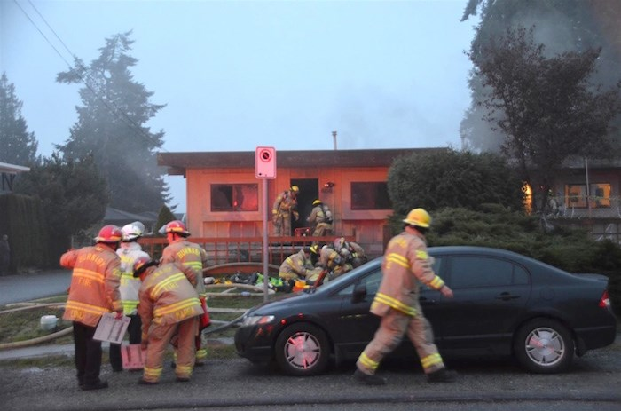 Firefighters at a house on 16th Avenue in Burnaby. Photo by Curtis Kreklau