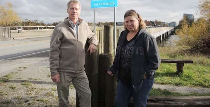 Michael Fleck and Tami Arseneault have had enough of someone throwing excrement onto the Dinsmore Bridge. Alan Campbell photo