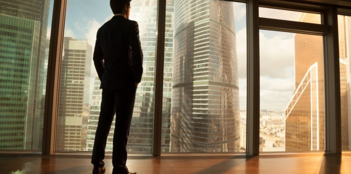 Young man in downtown high rise/Shutterstock