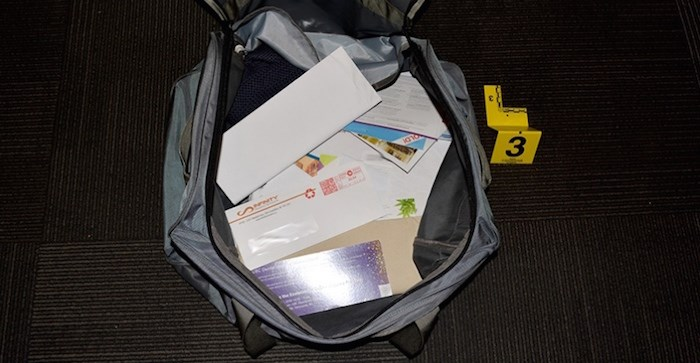 A bag of allegedly stolen mail was found at a Surrey home on Oct.11 and two people are charged with a number of mail theft offences. Photo courtesy Coquitlam RCMP