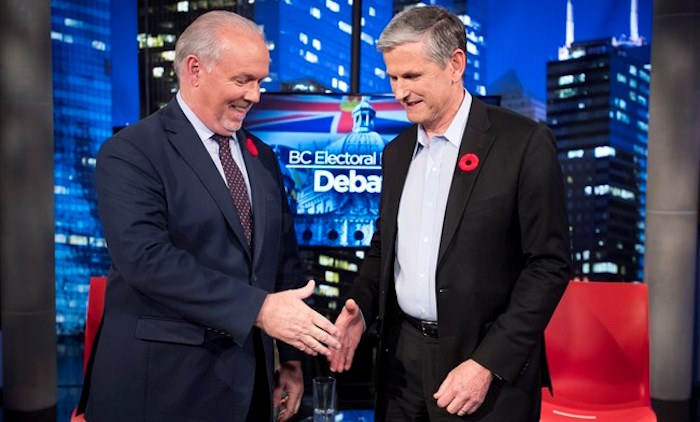 Premier John Horgan and Liberal leader Andrew Wilkinson following the Electoral Reform Debate at Global Television in Burnaby, B.C. Thursday, Nov., 8, 2018. THE CANADIAN PRESS/Jonathan Hayward