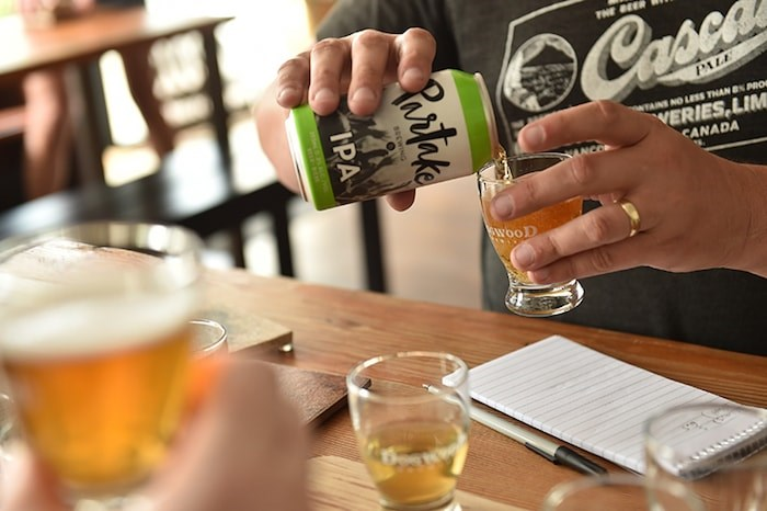 Trying out several non-alcoholic beers (Photo by Dan Toulgoet)