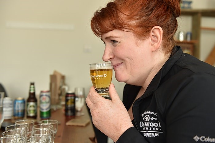 Claire Wilson tries out some near beers (Photo by Dan Toulgoet)