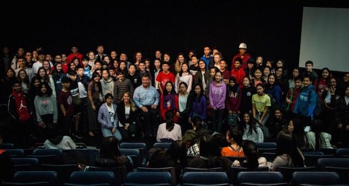 Rick Hansen poses for a photo with students at J.N. Burnett Secondary School. Photo: Cristina Carvalheiro