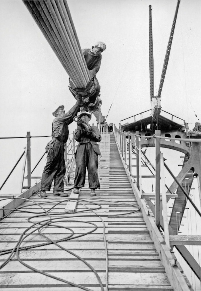 Workers building the Lions Gate Bridge circa 1938. Photo courtesy West Vancouver Archives