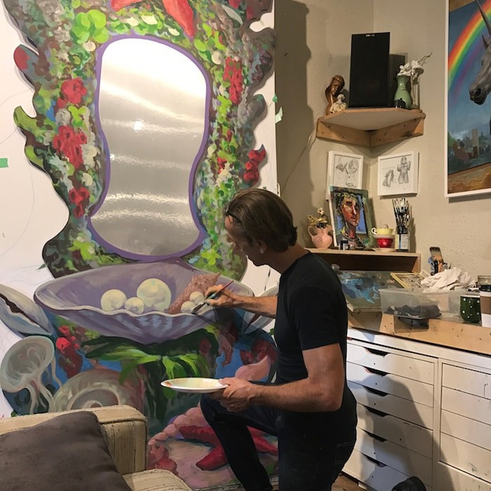 Canadian surrealist artist Michael Abraham is handpainting props and backdrops for the musical. Photo: Children's Theatre of Richmond Association