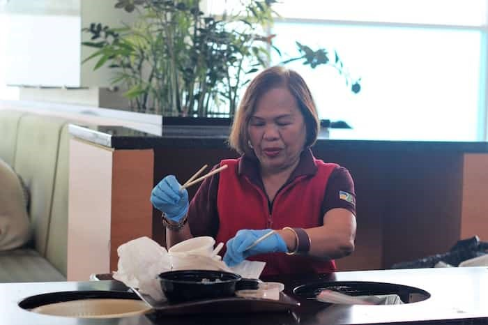 Janitorial staff at Aberdeen Centre help sort chopsticks from food court trays. Photo: Alyse Kotyk