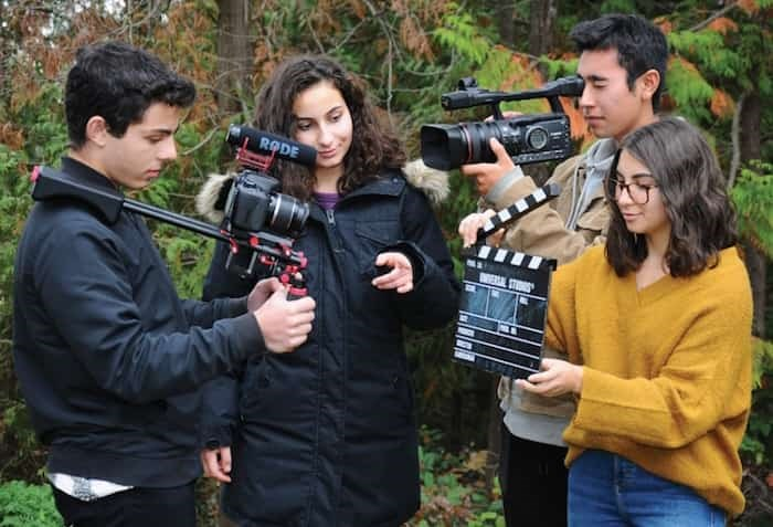Rockridge Secondary film students Josh Yaron, Isabelle Launhardt, Jade Weinstein and Kai Toku-Contreras are gearing up to spend four nights in a 109-year-old abandoned inn-turned yacht club outstation on Indian Arm. photo Cindy Goodman, Deep Cove Crier