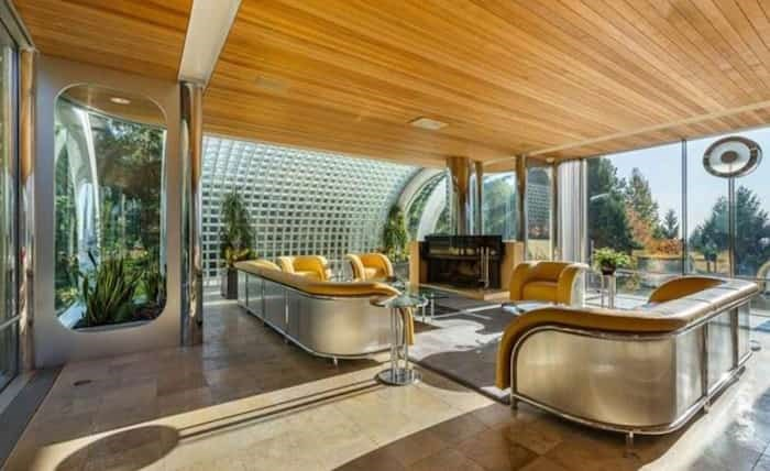 The spectacular living room comes complete with original furniture designed by Arthur Erickson especially for this house. Listing agent: Eric Latta