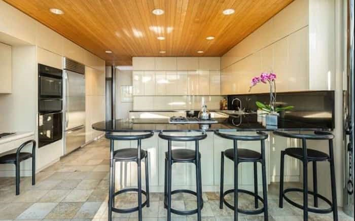 The kitchen of this Erickson house has a curved peninsula and updated appliances. Listing agent: Eric Latta