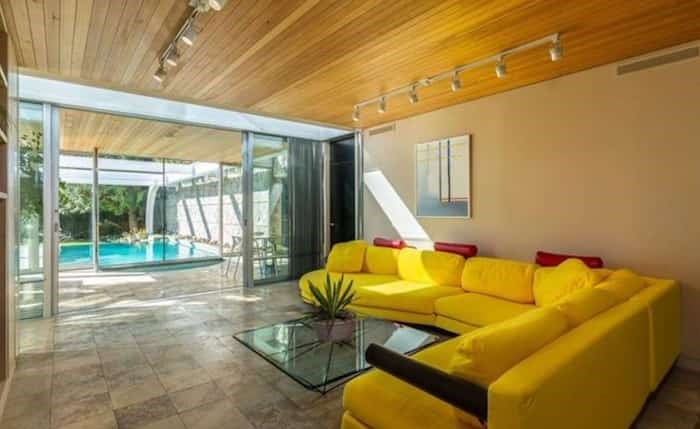 The more relaxed family room leads out to the hot tub and pool area. Listing agent: Eric Latta