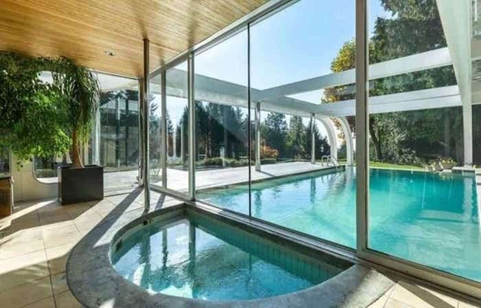The outdoor pool is on the other side of the glass wall from this indoor hot tub. Listing agent: Eric Latta