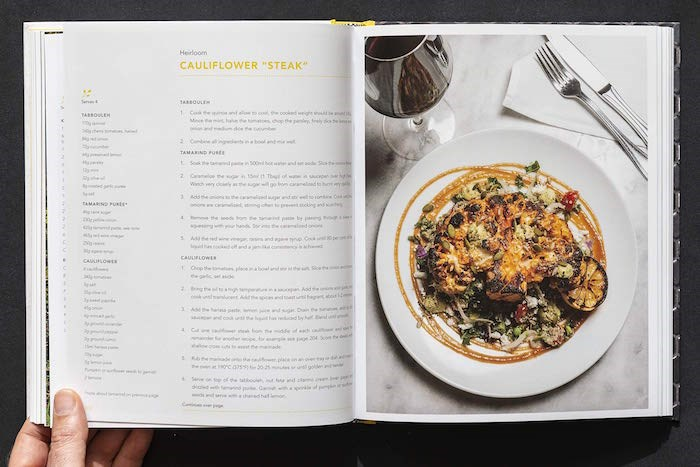 The recipe for Heirloom's Cauliflower Steak is included in the cookbook The Plant-Based Foodie