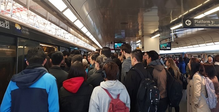Crowds gathered at the Broadway-Commercial SkyTrain station. Photo by Tracey Young