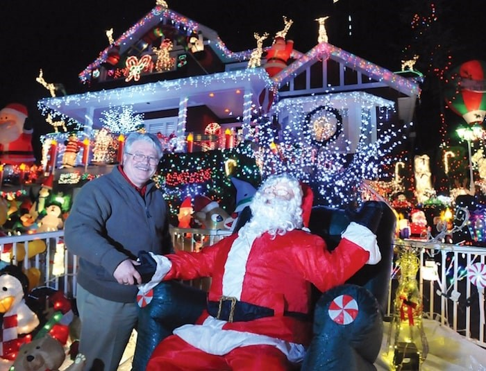 John Ribalkin stands in front of his festive home decked out for charity, at 4967 Chalet Pl., during a previous holiday season. Photo by Paul McGrath, North Shore News