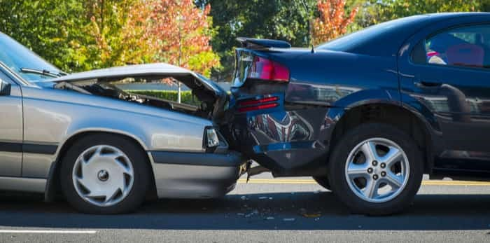 Auto accident involving two cars on a city street / Shutterstock