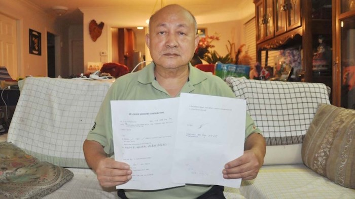 Hongwei Zhao is one of 17 residents in Metro Vancouver who claim to be the victim of a renovation scammer on Wechat. Zhao shows the contract signed by him and the