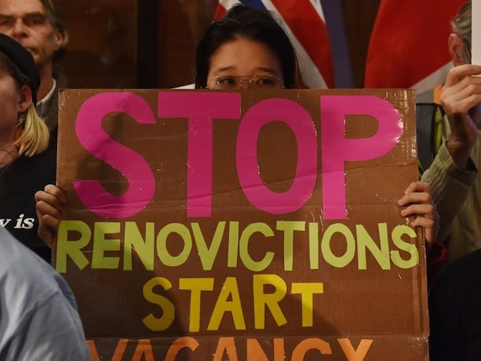 One of the signs at a renters' rally held before council voted on the renovictions motion. Photo Dan Toulgoet