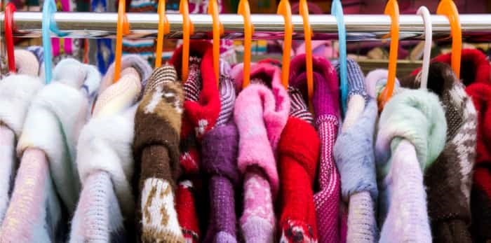 Colorful thick warm winter coats at a market / Shutterstock
