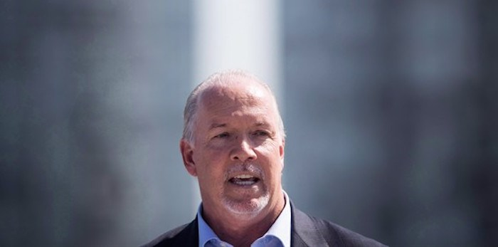 B.C. Premier John Horgan speaks during an announcement in Surrey, B.C., on September 4, 2018. British Columbia's Premier John Horgan is warning the federal parties to play nice in the final leg of the 2019 election campaign. THE CANADIAN PRESS/Darryl Dyck