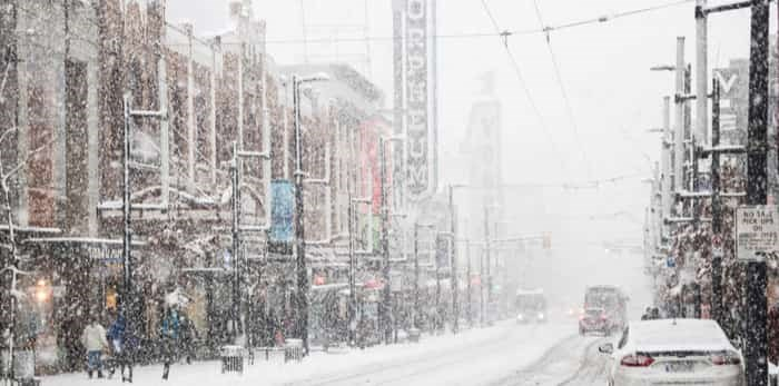 Vancouver, CANADA - 23 Feb, 2018 : Granville street in Downtown Vancouver in winter while it has snow storm, British Columbia, Canada / Shutterstock