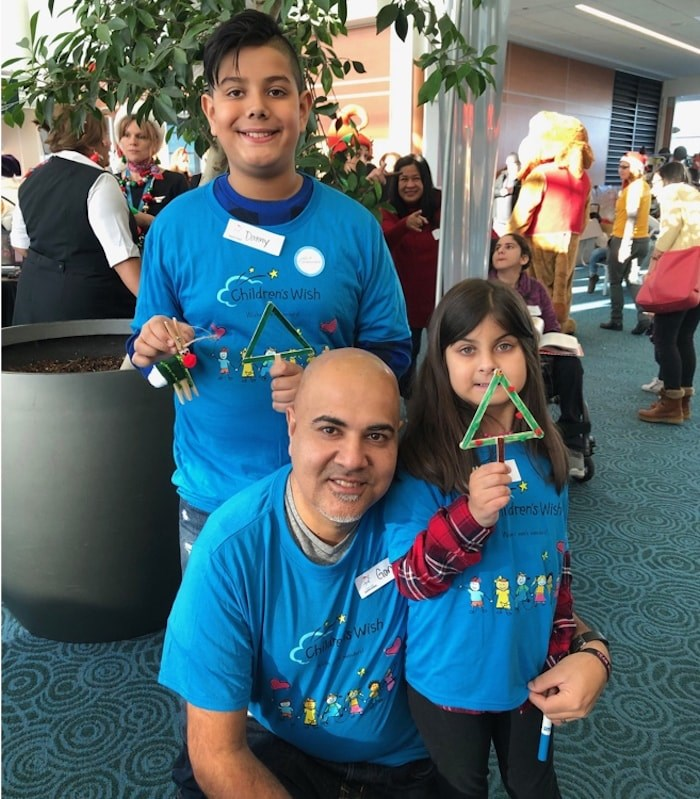 Maya Ahuja, 8, with her dad Gary and older brother Danny, 11, waiting to board the Flight with Santa. Photo Jessica Kerr