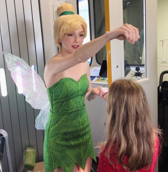 Tinkerbell sprinkled all the kids with fairy dust and told them to think good thoughts before the plane took off. Photo Jessica Kerr