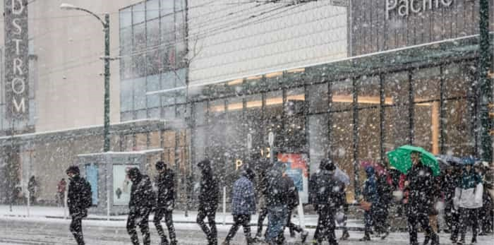 Winter time with Snow storm in Downtown Vancouver, Canada / Shutterstock
