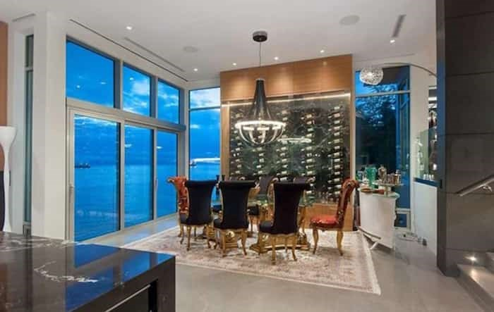 The dining room is open to the kitchen and has a matching black-marble-clad wine-storage wall. Listing agent: Nafiseh Samsam