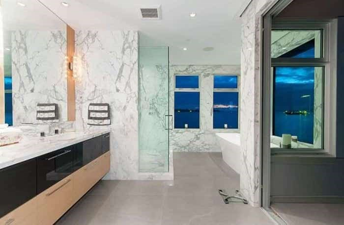 The incredible master bathroom has a tub with epic views, and a concertina door to a private upper deck. Listing agent: Nafiseh Samsam