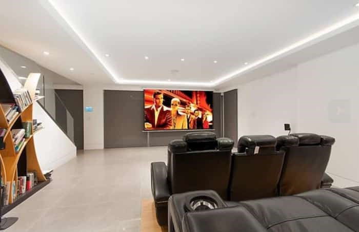The lower level has a movie theatre and offers access to the pool and lower spa terrace. Listing agent: Nafiseh Samsam
