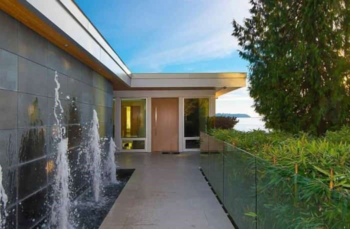 The elegant front entry, complete with a row of fountains, is on the upper level of the home, as is the parking garage. Listing agent: Nafiseh Samsam