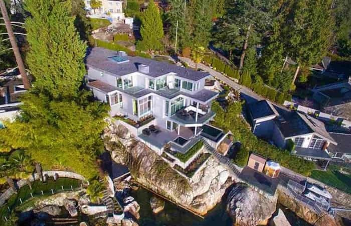 The large house is built over three levels on an oceanfront bluff on chi-chi Marine Drive in West Vancouver. Listing agent: Nafiseh Samsam