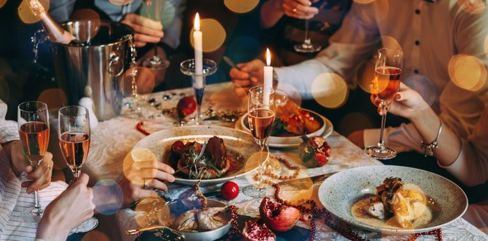 Gathering at the holiday table (Shutterstock)