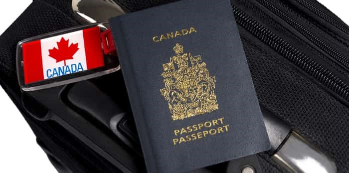 Canadian passport on luggage / Shutterstock
