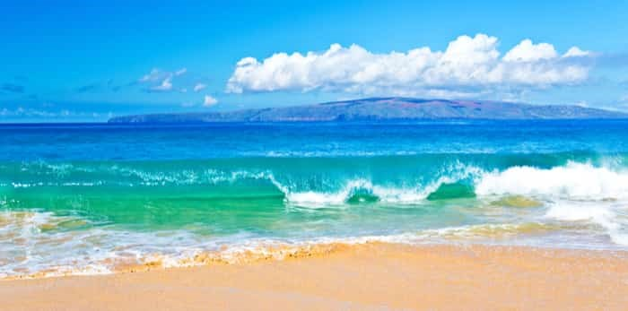 Ocean Surf in a Tropical Beach Vacation of Maui Hawaii in the Pacific / Shutterstock