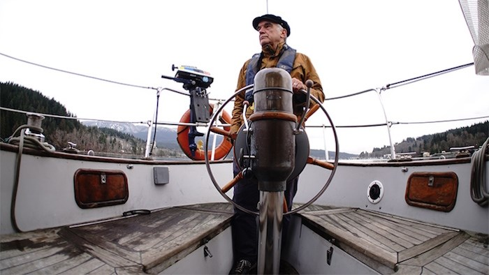 Rob Butler captains a boat on a journey around the Salish Sea to visit artists and professionals for the documentary Returning, which will be shown at the Inlet Theatre in Port Moody Jan. 18. Photo by Mike McKinlay