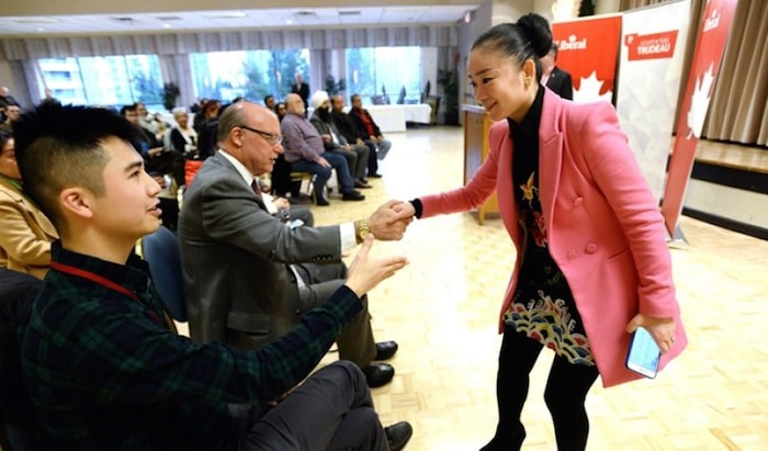 Karen Wang shakes hands with Burnaby South Liberal supporters. Photo by Jennifer Gauthier.