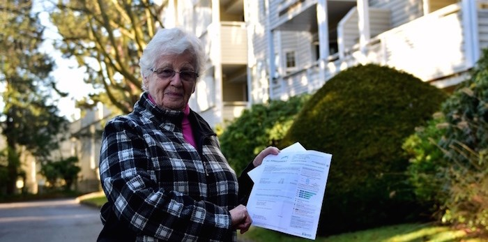 Louise McManus stands outside her condo on Moffatt Road holding her letter from BC Assessment. Her home's assessed value jumped by 37 per cent since last year, more than four times the city-wide average for condos. Photo: Megan Devlin/Richmond News