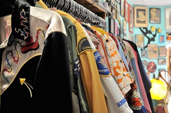 Shirts — from cowboy to Hawaiian to Canada Customs — on a rack at Pinball Alley. Photo by Mario Bartel/Tri-City News