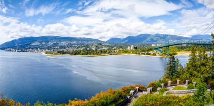 Vancouver skyline panorama taken at Prospect Point in Stanley Park with Lions Gate Bridge on right and West Vancouver on left. / Shutterstock