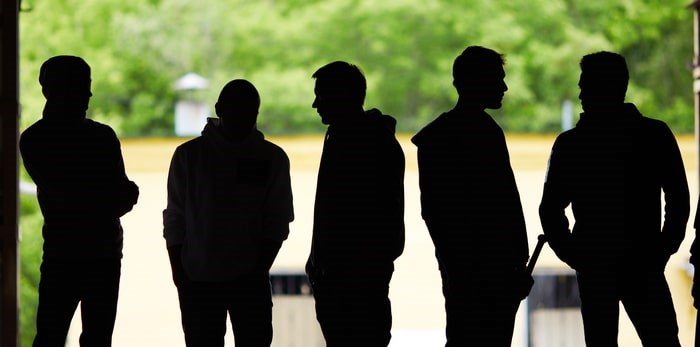 Young men in the shadows/Shutterstock