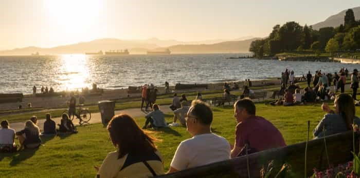 Vancouver, Canada - May 2017. People Enjoy the sunshine at English Bay Beach / Shutterstock