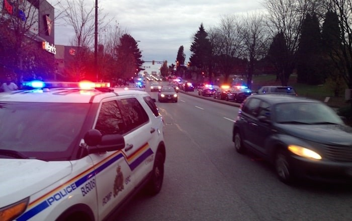 Dozens of police officers from Vancouver and the RCMP rushed to a Canadian Tire store on Grandview Highway Nov. 10, 2016 to respond to reports of a man robbing the store. Police killed the man outside the store's front door. Photo by Mike Howell